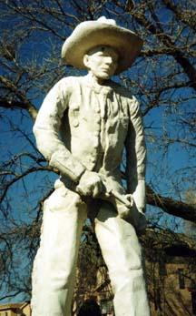 [photo: Cowboy Statue on Boot Hill, Dodge City, by Dr. Oscar Simpson, DDS, 1929. C. 1998, G.L.]