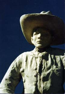[Photo: 1929 Cowboy Statue on Boot Hill, Dodge City, KS. Copyright, G. Laughead]