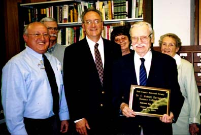 [Photo:  Dr. C. Robert Haywood: R.I.P. August 6, 2005: Shown being honored in May 2003 for his 400-volume library donation to the Ford County Historical Society, Dodge City, KS. Jim Sherer, Kansas Heritage Center director (l.) and George Laughead Jr., FCHS president, are shown with Robert; wife, Marie Haywood; son, Ray Haywood; and daughter, Sandy Jarvis.]