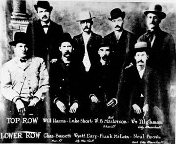 [Third version of photograph of the 'Dodge City Peace Commission' in June, 1883. Front, l-r; Chas. E. Basset, Wyatt S. Earp, Frank McLain, and Neil Brown. Back, l-r; W. H. Harris, Luke Short, W. B. Bat Masterson, and William Tilghman's head placed on W.F. Petillon's body. All rights reserved. FCHS.]