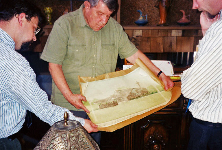 Jay Price, Glen Mitchell, and Kent Salisbury look over original drawings by Bruce Goff of Mitchell house, May 11, 2007.