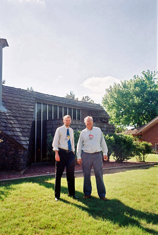 Kent Salisbury and George Laughead Jr. outside east side of Bruce Goff house.