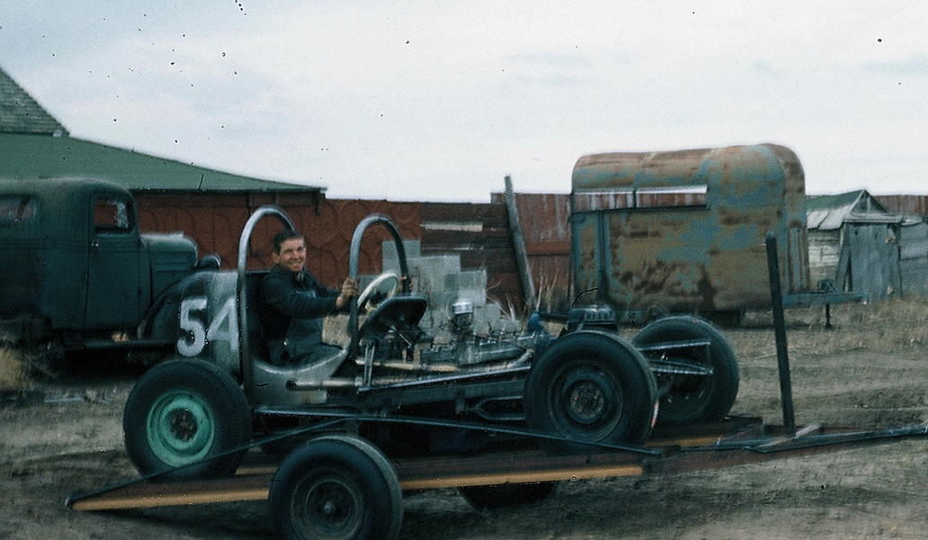 [photograph: David Davey Ross, Flying Farmer, in No. 54 at McCarty Speedway, Dodge City, 1961 Second car Ross built -- he was 17 years old. Car was pink -- now owned and restored by Troy Burnett, Dodge City, KS.]