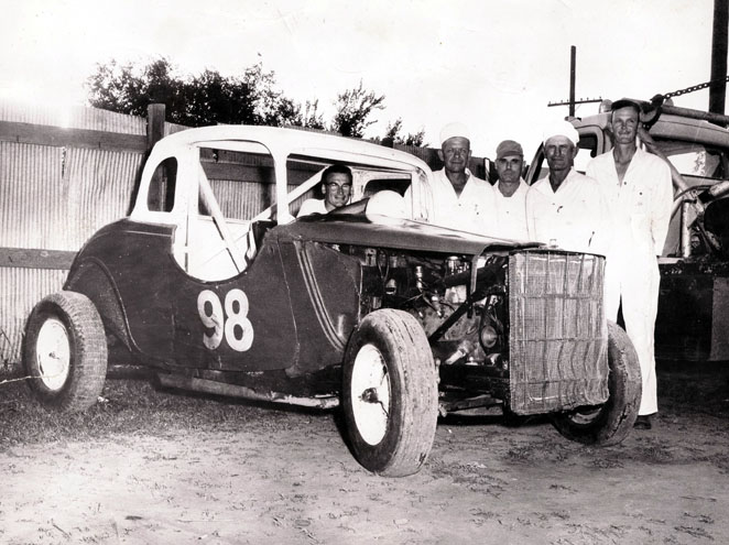 [photograph: 1956 Trophy Dash Champion Team, McCarty Speedway, Wright Park, Dodge City, KS.]